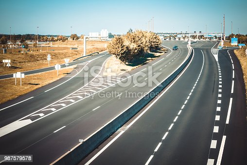 istock Miltilane highway with a toll payment point 987579578