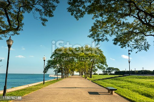 Tree lined path of Milton Lee Olive Park waterfront  in Chicago Illinois USA