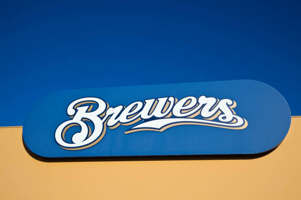 Milwaukee Brewers Milwaukee, Wisconsin, USA - August 24, 2011: Brewers sign in front of Miller Park in Milwaukee against blue sky. Milwaukee Brewers is a professional baseball team playing in Central Division of Major League Baseball milwaukee brewers stock pictures, royalty-free photos & images