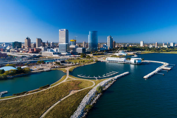 Milwaukee Coast Aerial With Downtown Skyline Aerial view of the Milwaukee skyline and the coast of Milwaukee with Lakeshore State Park in the foreground. milwaukee wisconsin stock pictures, royalty-free photos & images