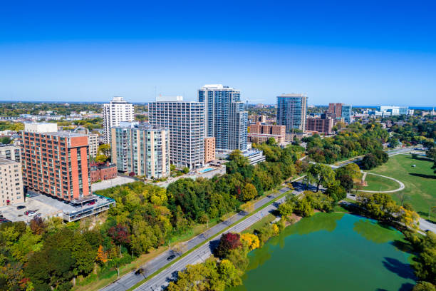 Milwaukee East Side Neighborhood Aerial with Lagoon Aerial of high-rise apartments/condo buildings of Milwaukee's East Side neighborhood with Veterans Lagoon (of Veterans Park) in the foreground. milwaukee wisconsin stock pictures, royalty-free photos & images