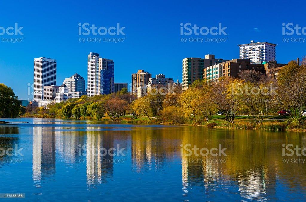 Milwaukee skyline and lagoon in Veterans Park during Autumn stock photo