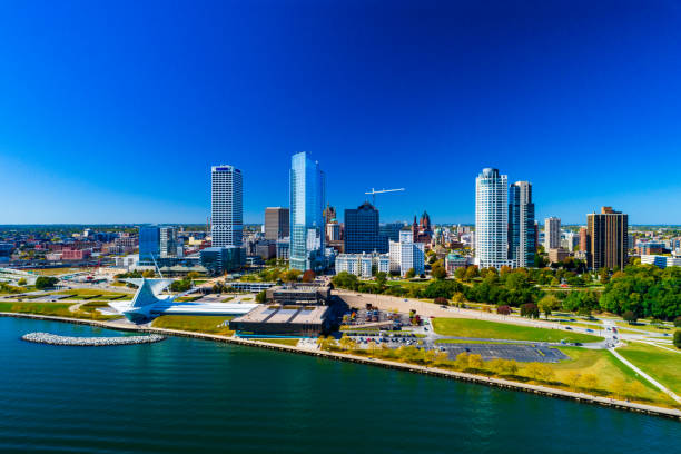 Milwaukee Skyline And Shoreline Aerial Downtown Milwaukee skyline view with the shoreline of Lake Michigan in the foreground. milwaukee wisconsin stock pictures, royalty-free photos & images