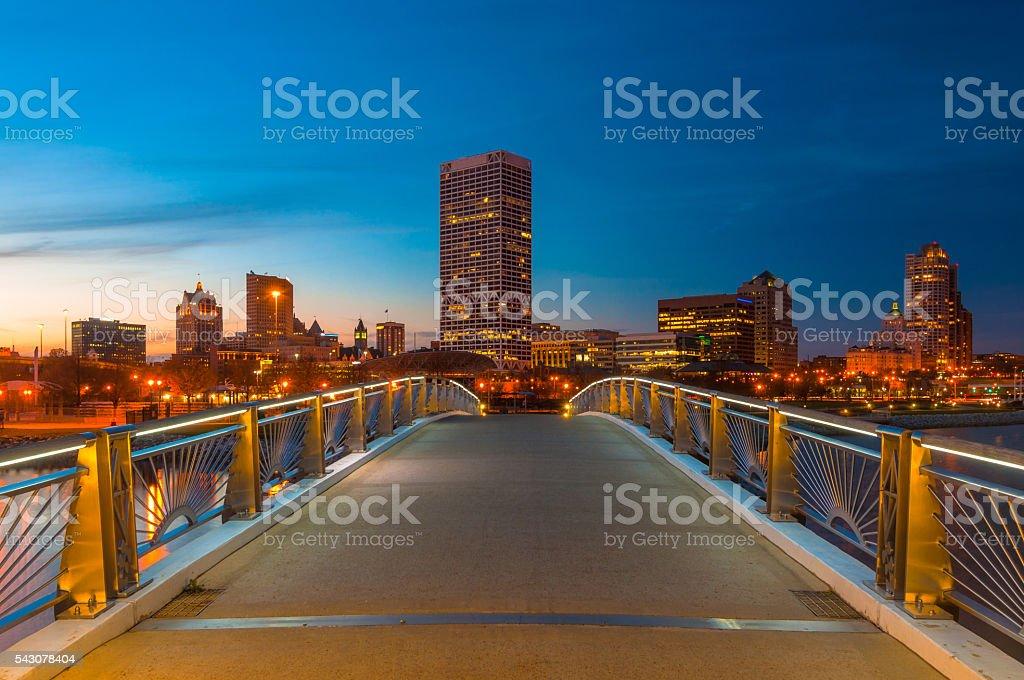 Milwaukee skyline at dusk from a pedestrian bridge stock photo