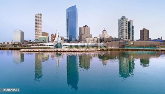 Milwaukee's beautiful, modern city skyline, downtown, reflected in the tranquil waters of Lake Michigan.