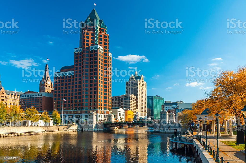 Milwaukee skyscrapers and river with Autumn trees stock photo