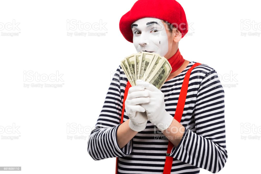 mime covering mouth with dollars isolated on white stock photo