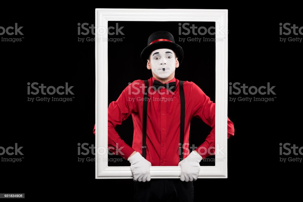 mime holding frame isolated on black stock photo