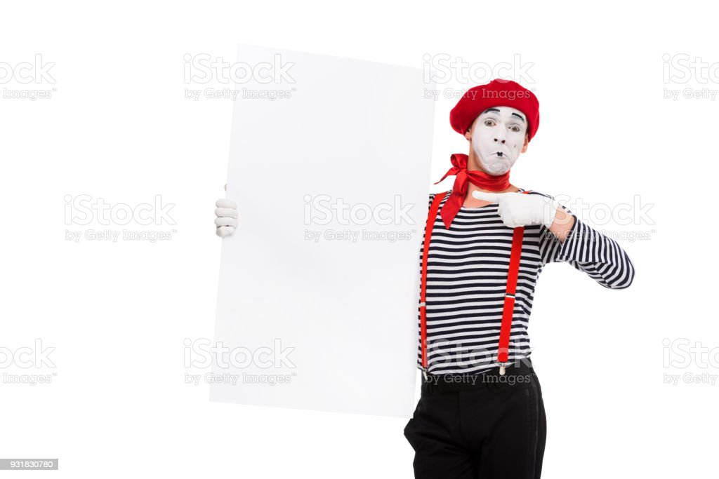 mime pointing on empty board isolated on white stock photo