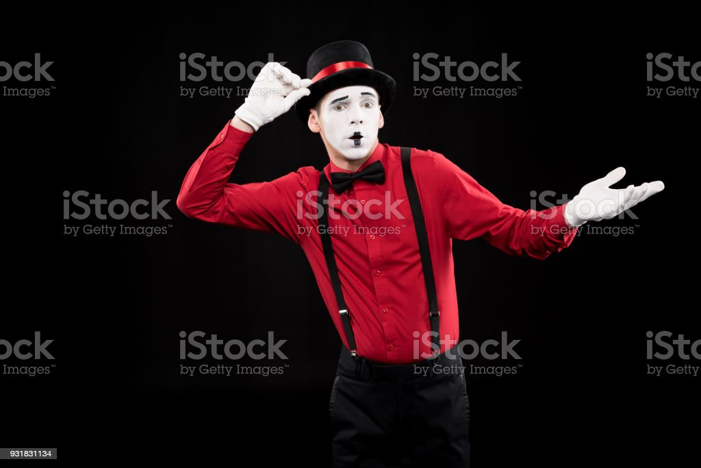 mime showing shrug gesture isolated on black stock photo