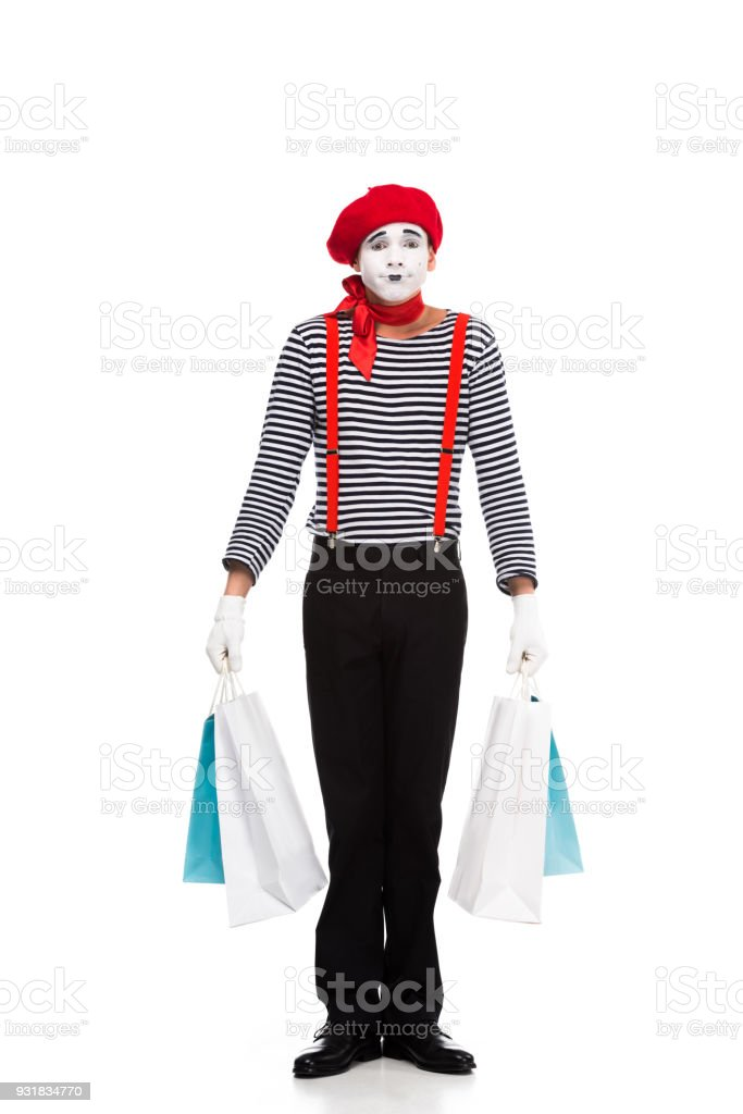 mime standing with shopping bags isolated on white stock photo