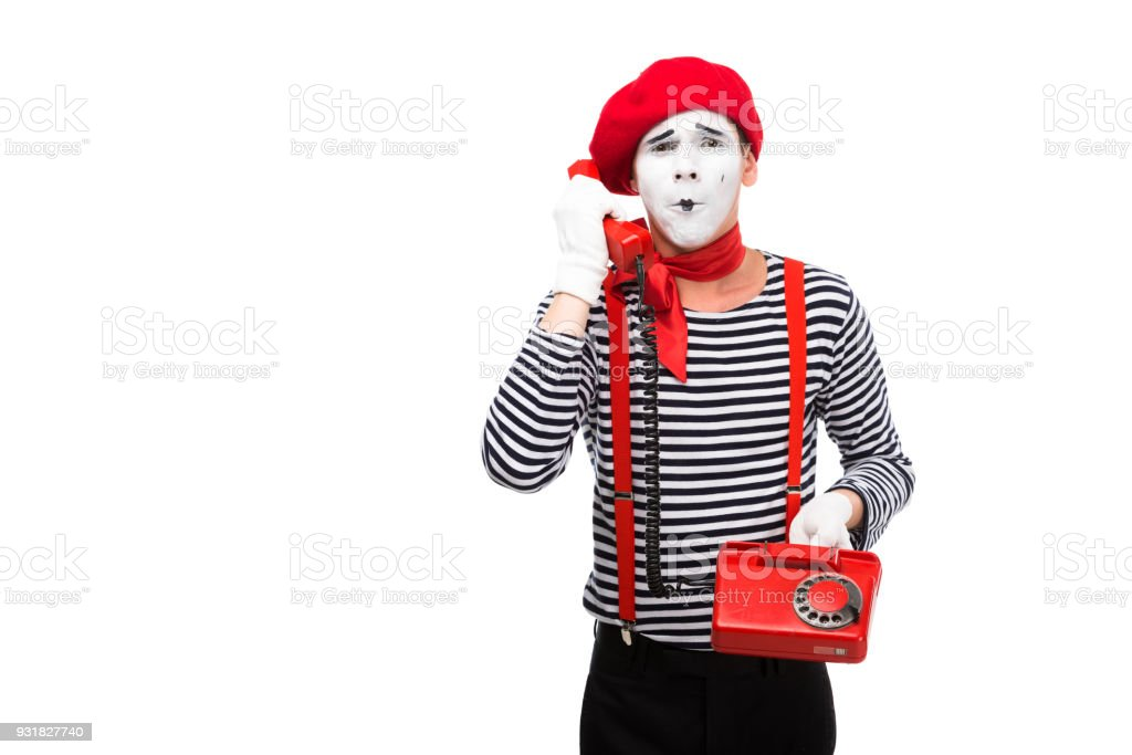 mime talking by stationary telephone isolated on white stock photo
