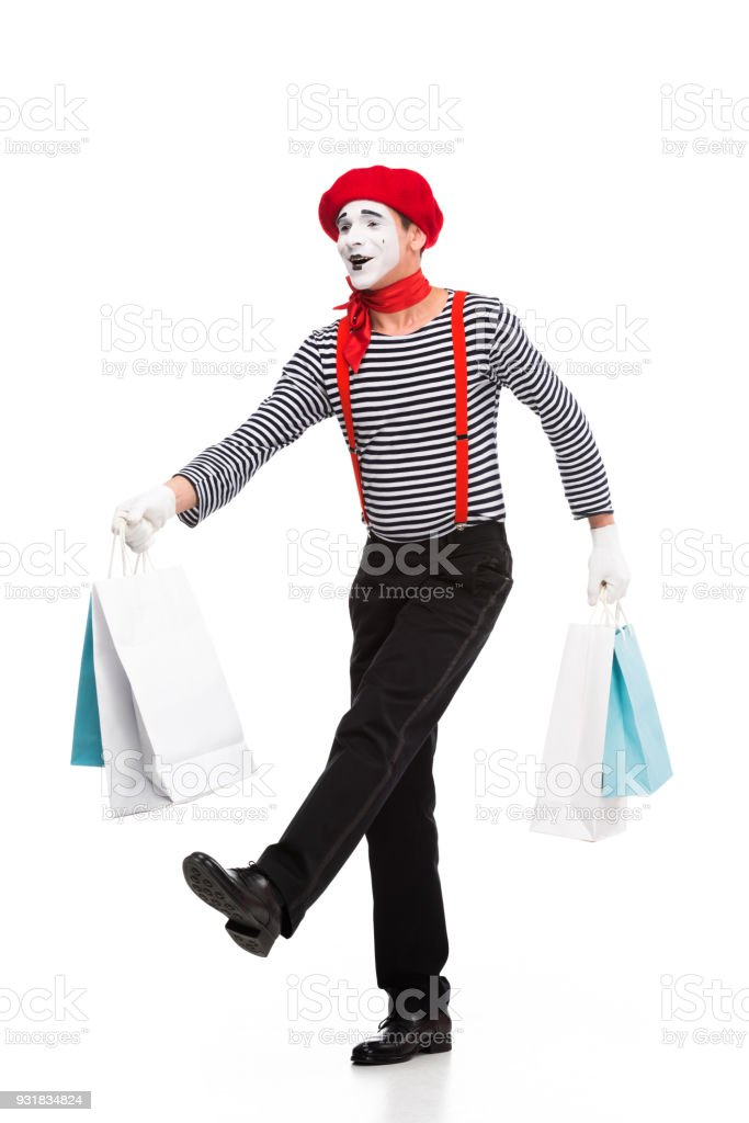 mime walking with shopping bags isolated on white stock photo