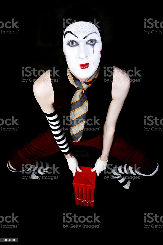 mime with  red gift box on black background royalty-free stock photo