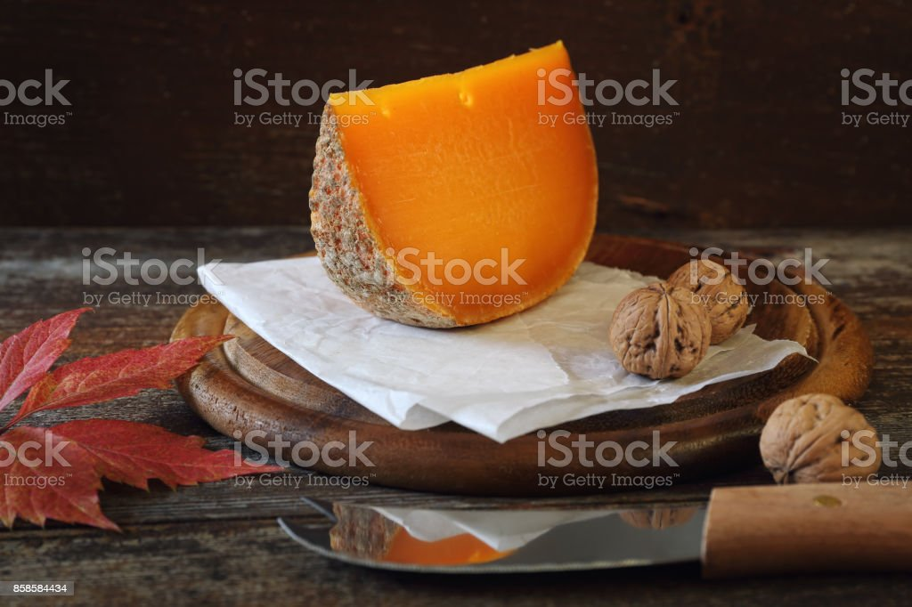 Mimolette cheese and walnuts stock photo