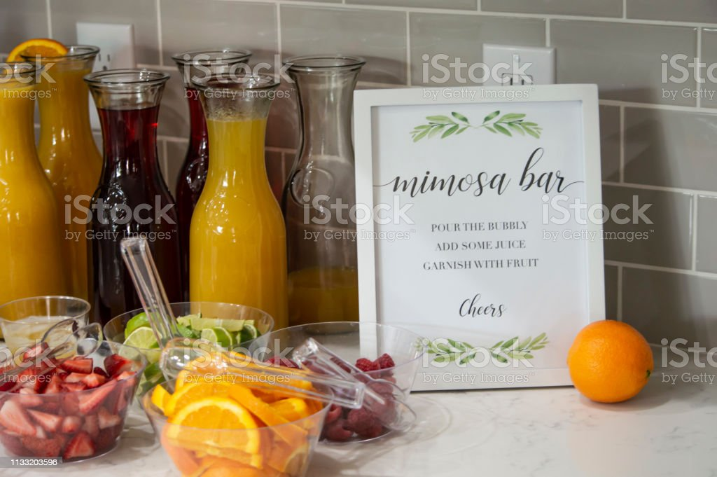 A mimosa bar with freshly sliced fruit stock photo