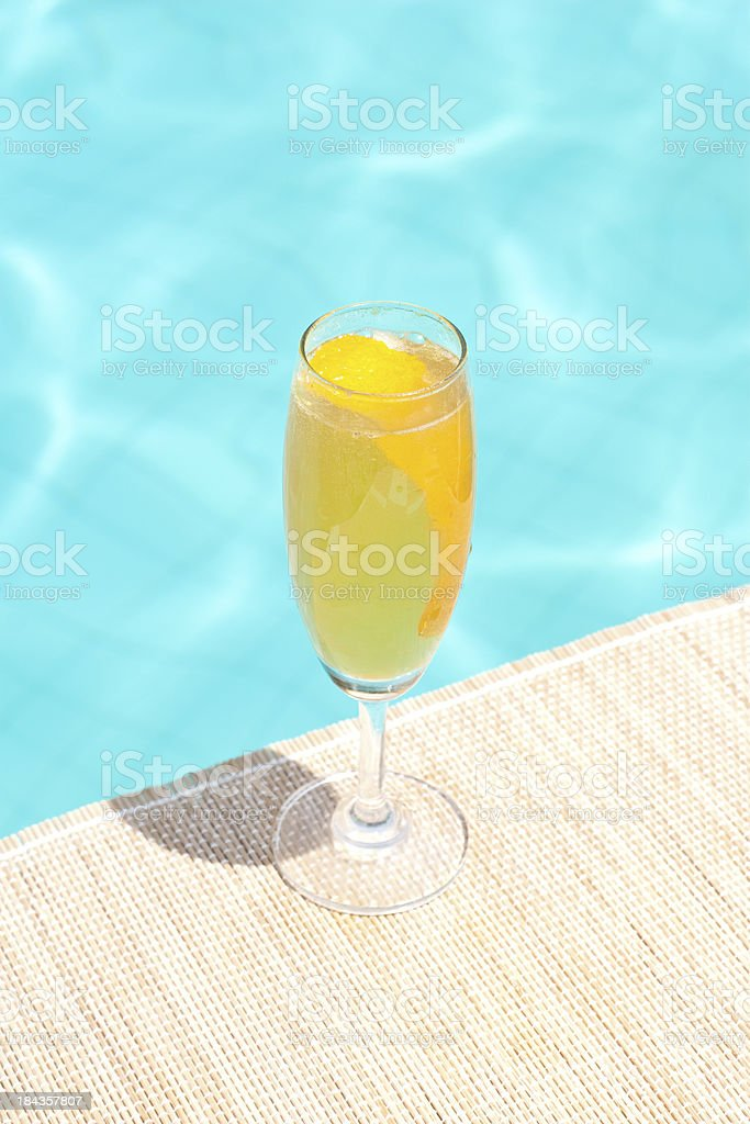 Mimosa classic cocktail near waterpool on the mat stock photo