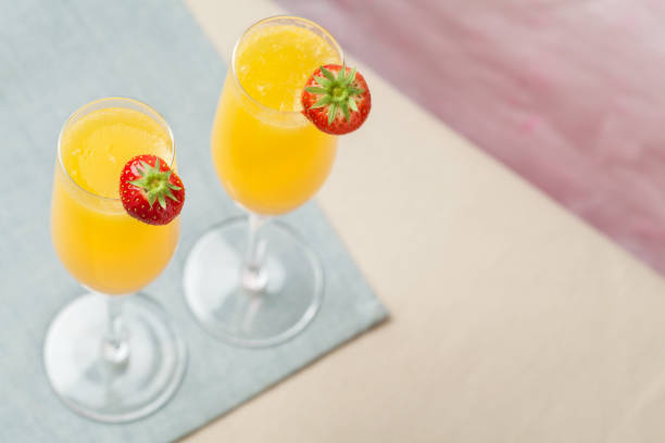 Mimosa cocktail and strawberries stock photo