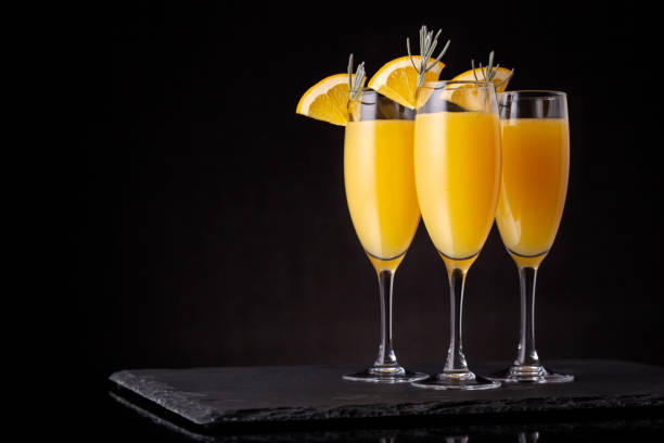 Mimosa cocktails in champagne glasses stock photo