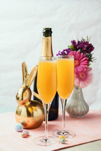 Mimosa cocktails with Easter decoration stock photo