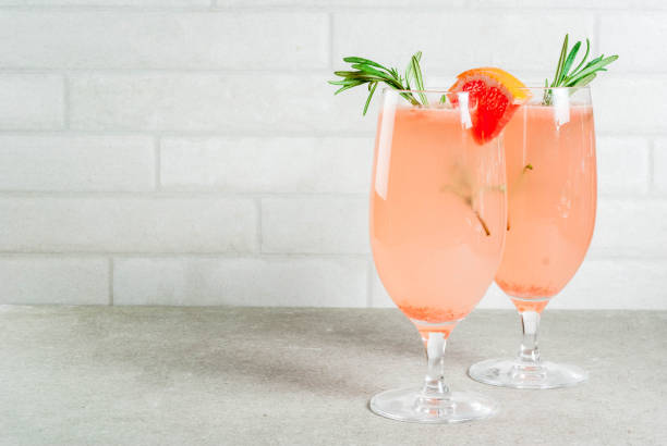 mimosa drink for christmas party - grapefruit cocktail stock photos and pictures