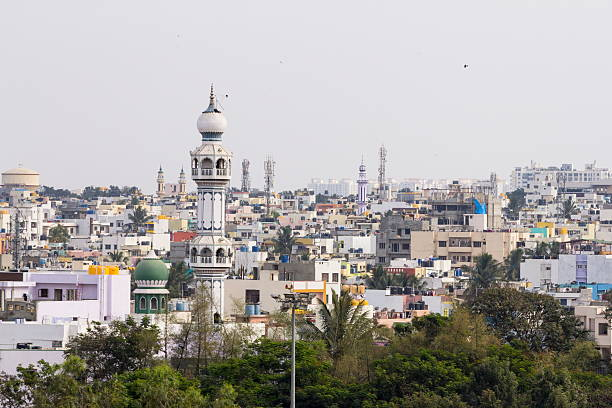 Minaret of mosque, Bangalore, India Bangalore, India - March 1, 2016: A minaret of a mosque juts out in a residential district in south Bangalore, India. Many localities of Bangalore have a significant population of Moslems, and local mosques cater to this population. bangalore stock pictures, royalty-free photos & images