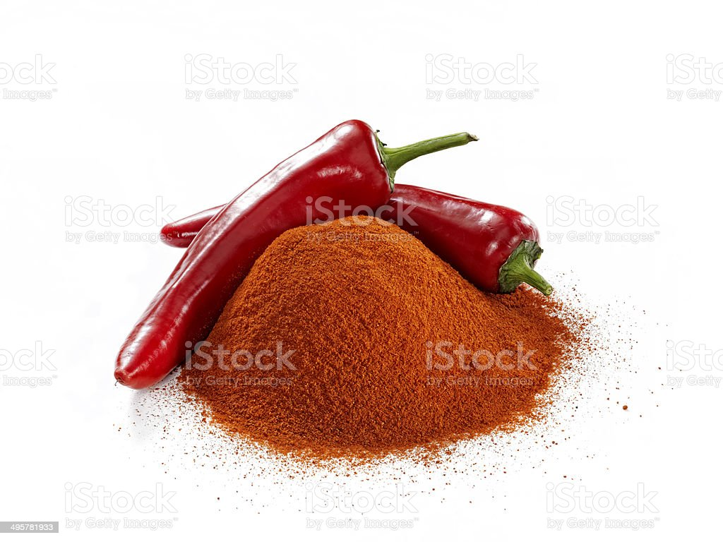 Minced and whole red peppers on white background stock photo