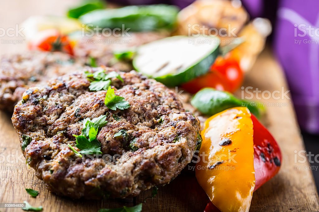 Minced burgers. Roasted burgers with grilled vegetable stock photo