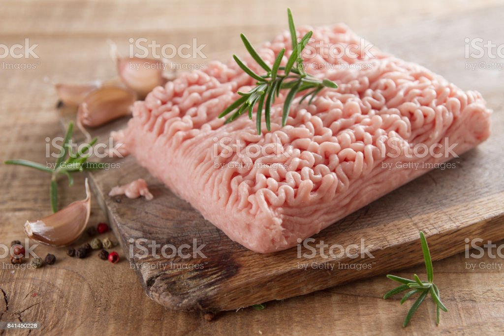 Minced chicken or turkey meat stock photo