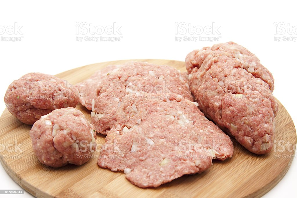Minced meat formed on edge board stock photo