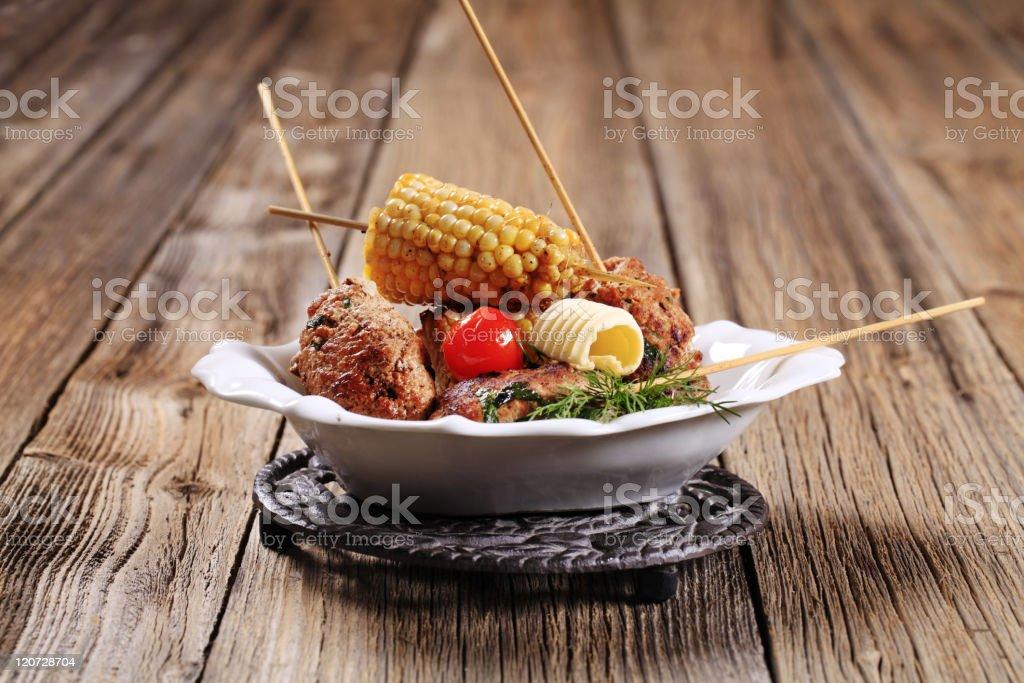 Minced meat kebabs on wooden skewers royalty-free stock photo