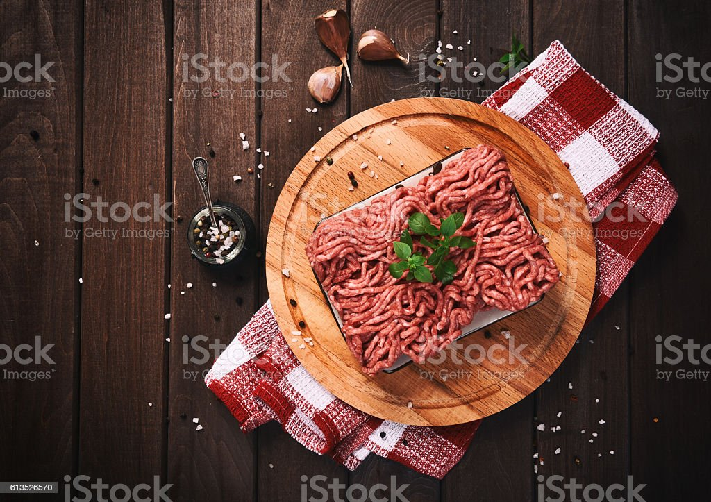 minced meat on a wooden table stock photo