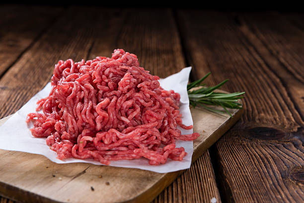 Minced Meat Minced Meat (close-up shot) on vintage wooden background chopped food stock pictures, royalty-free photos & images