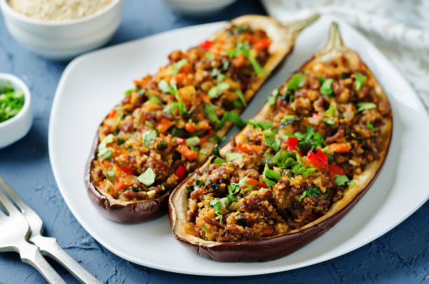 Minced meat quinoa vegetables stuffed eggplants stock photo