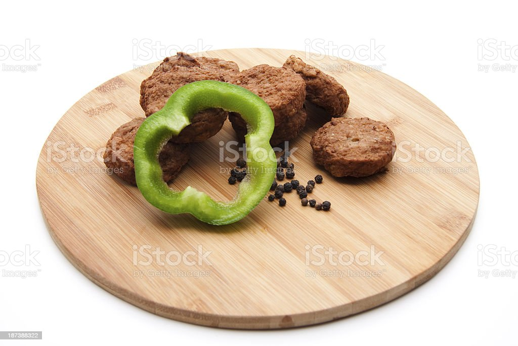 Minced meat small ball with paprika on wooden plate stock photo