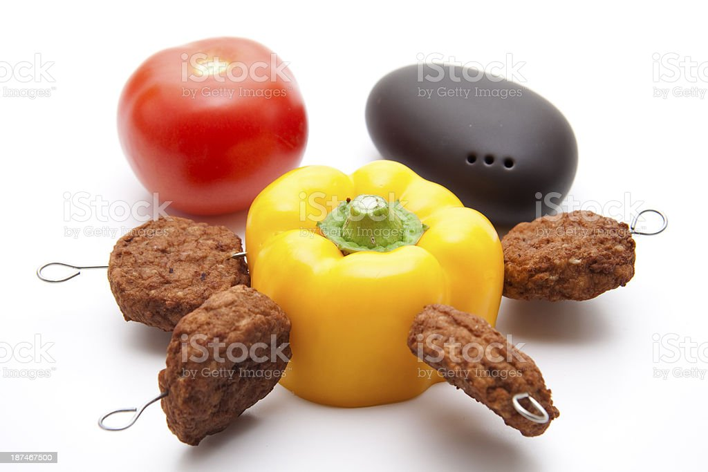 Minced meat with paprika on spit stock photo