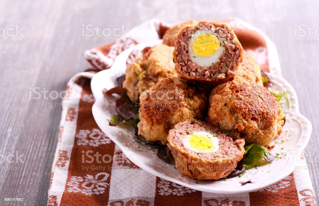 Mincemeat balls with eggs inside stock photo