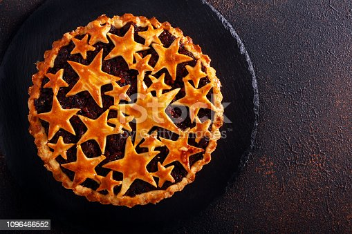 Mincemeat pie over dark background, top view