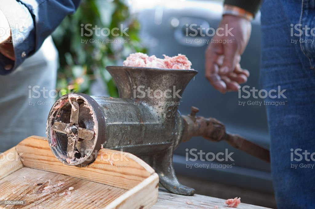 Mincer and a pile of chopped meat royalty-free stock photo