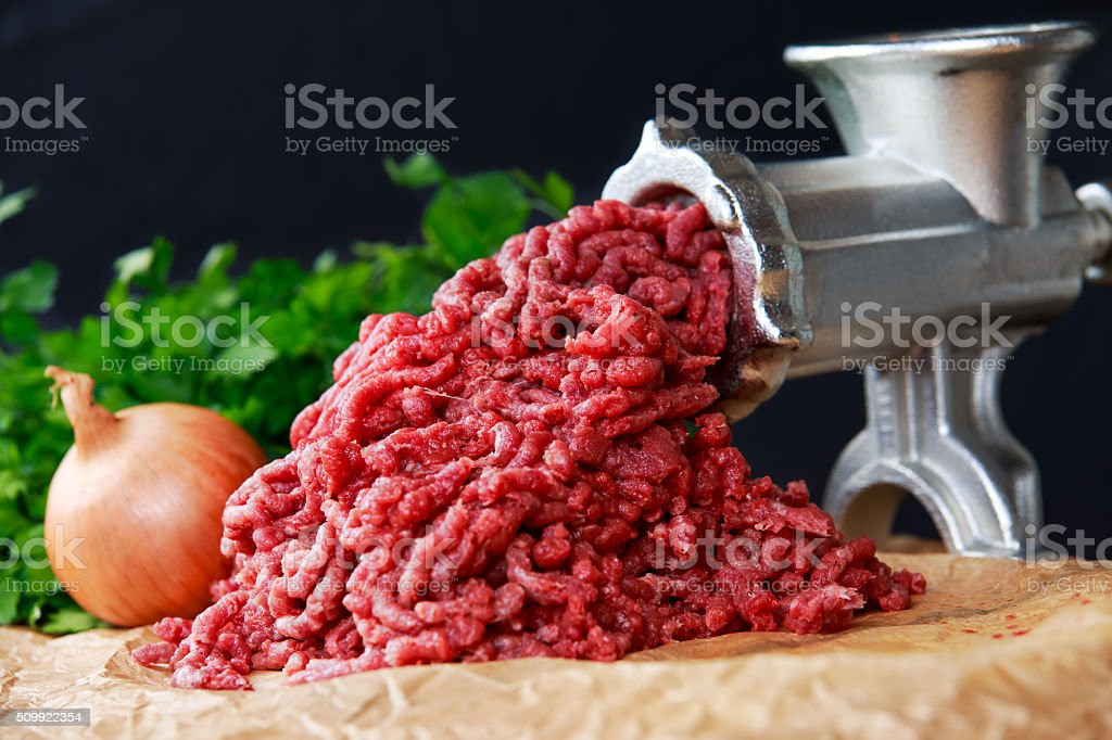 Mincer with fresh minced meat stock photo