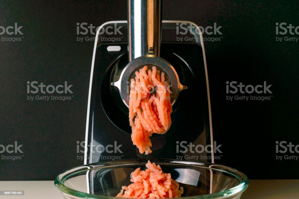 Mincing machine and meat foto stock royalty-free