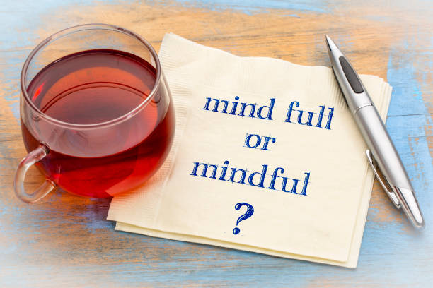 Mind full or mindful question Mind full or mindful ? Inspiraitonal handwriting on a napkin with a cup of tea. full stock pictures, royalty-free photos & images