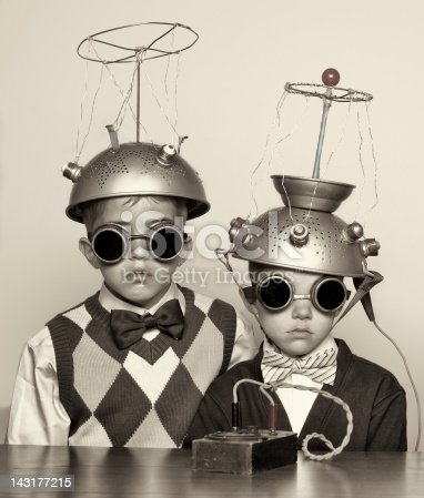 Vintage portrait of a couple of boys experimenting with their mind reading machine.