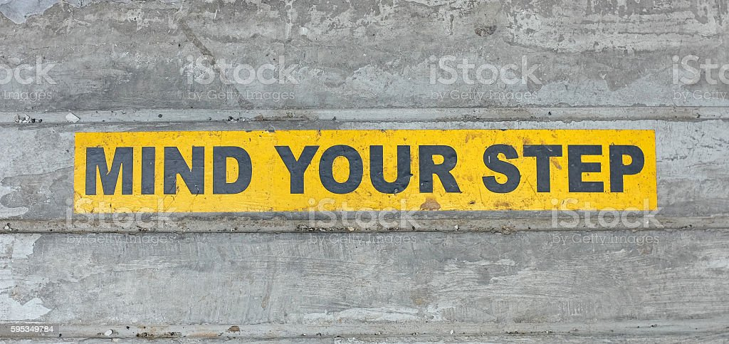 mind your step sign background stock photo