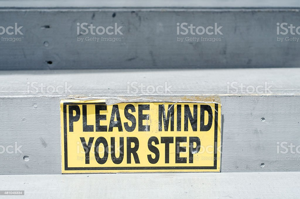 mind your step sign stock photo