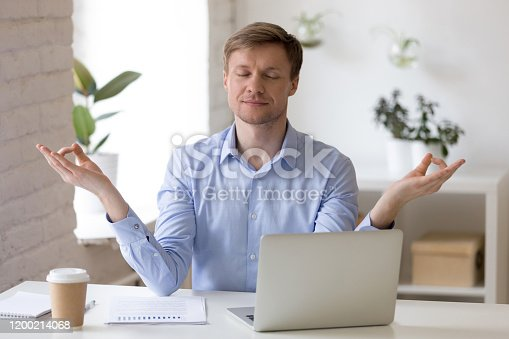 916520034istockphoto Mindful middle aged businessman reducing working stress. 1200214068