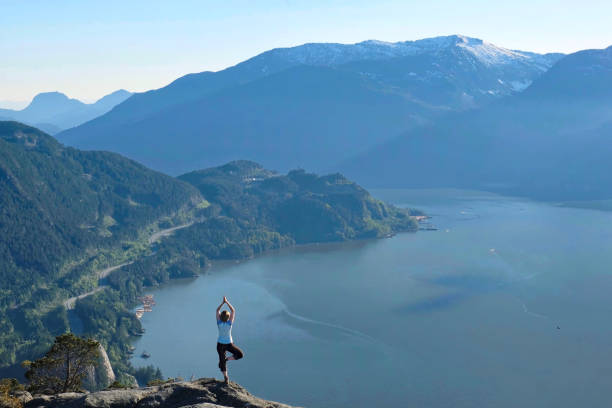 Mindfulness and inner peace. Outdoor yoga retreat. stock photo
