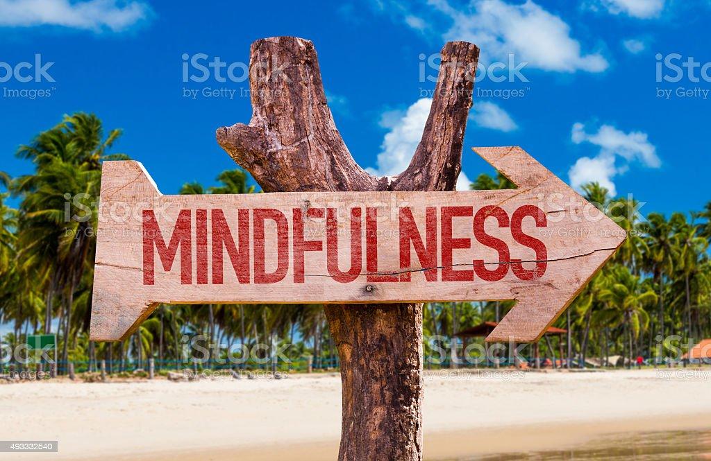 Mindfulness arrow with beach background stock photo