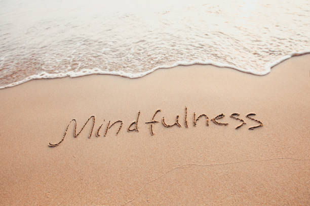 mindfulness concept, mindful living mindfulness concept, mindful living, text written on the sand of beach mindfulness stock pictures, royalty-free photos & images