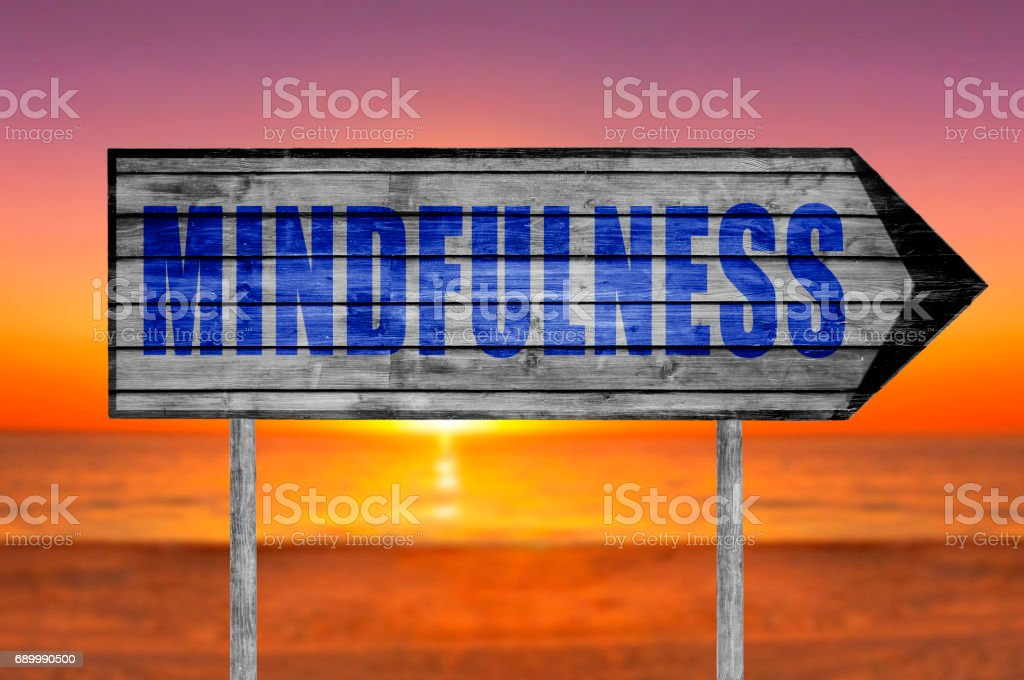 Mindfulness wooden sign with a beach stock photo
